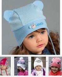 Качественная детская шапочка с завязками и без польской фирмы RASTER.