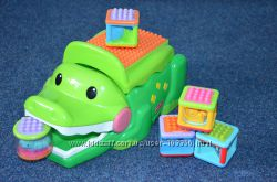 Крокодил музыкальный со строительными кубиками Fisher Price