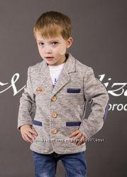 Стильный пиджак трикотажный для мальчика 98р.