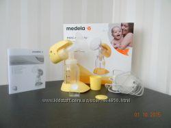 Молокоотсос Медела мини электрик