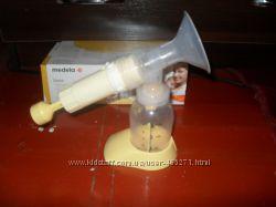 Продам механический молокоотсос Medela