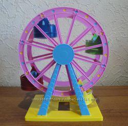 Большое колесо обозрения из парка развлечений свинки Пеппы.