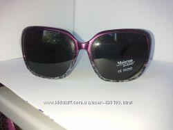 Женские солнцезащитные очки с поляризационными линзами.