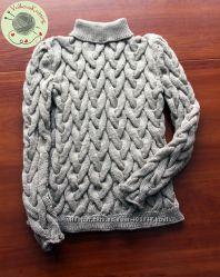 Теплый свитер с косами