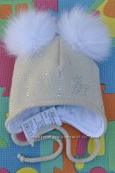 Зимние шапки с натуральными пампонами.
