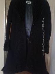 Стильное фирменное  оригинального кроя пальто