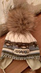 Суперкая шапочка с помпоном енота