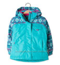 Яркие лыжные курточки, штаны, комбинезоны для девочек с C&A, выбор моделей