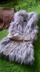 Меховая жилетка от Oodji