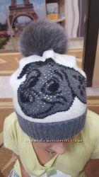 Продам детскую фирменную зимнюю шапку