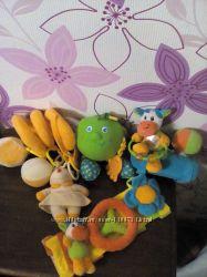 Фирменные игрушки на коляску