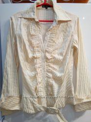 Элегантная рубашка с рюшами