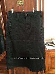 Чёрная прямая юбка классическая с интересными карманами