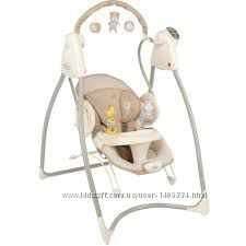 Электронные качели, стульчик,  укачивающий центр Graco США