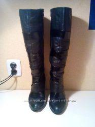 Высокие кожаные зимние сапоги на каблуке