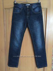 Нові, оригінальні, терті джинси Unlocked, модель 2016року